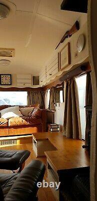 Touring caravan twin axle fixed bed